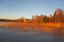 Från badplatsen Södra gärdet, med herrgården i bakgrunden