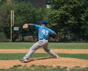 Pitcher at Mound, Throwing the Ball
