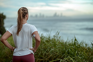 Diabetes woman ready for morning run along the coast