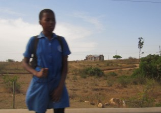 Girl by roadside in Swaziland