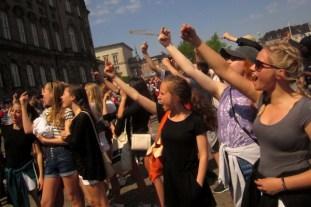 School children give the Danish parliament the finger in protest of unpopular school rform