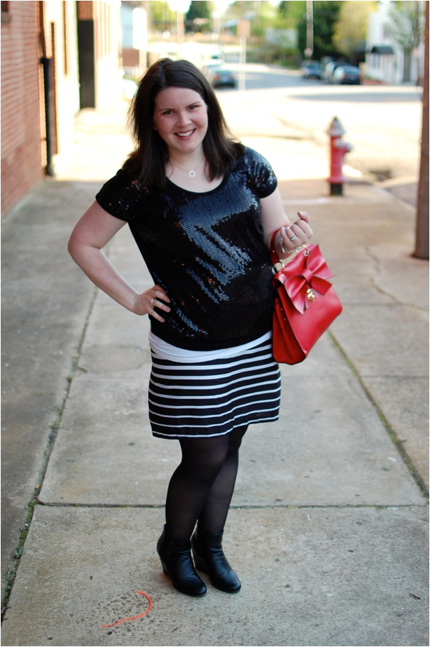 maternity style - black sequin shirt, black and white striped skirt, red bow bag, and Hanes tights