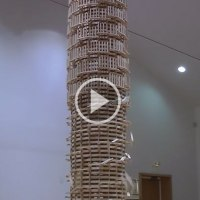 Overthrowing a Giant Domino Tower 2 Stories High is Simply Awesome