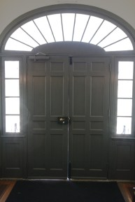 The main entry door to a building built in the early 1800s.