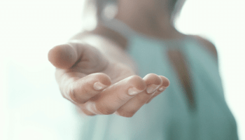 woman reaching out hand