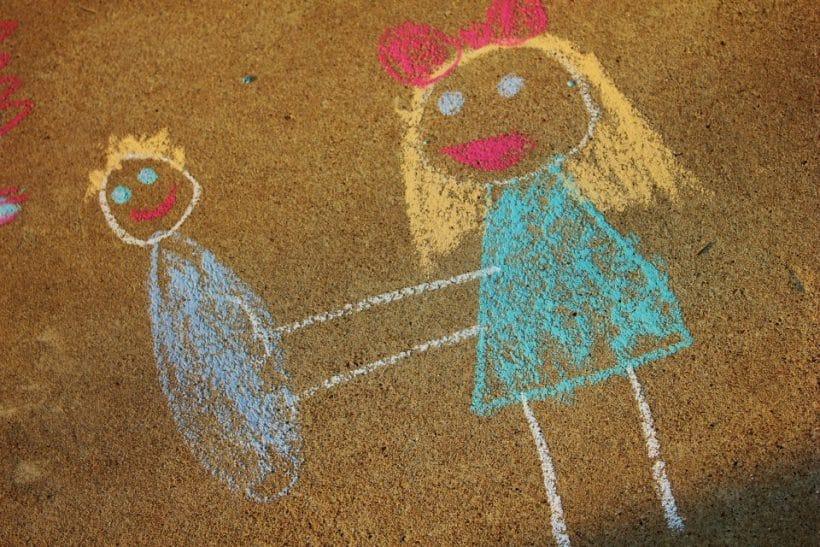 Empty Arms, Cradled Siblings: chalk drawing of siblings