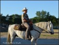Our finest brown on patrol. Yup, a true blue cowboy with hat, horse, and all. Wonder where the spurs went? Hmmm... lol.