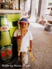 This little boy couldn't have been more than 5 years and was on the street selling back scratcher's. As you can see he is no taller than the bar top next to him. Las Flores, Mexico
