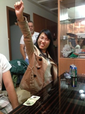 Xiaopei - She won the last round of cards and this is her super woman pose!