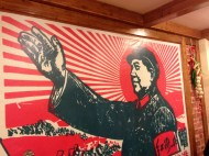 Large pictures of Mao Zedong are displayed thought out the restaurant.