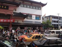 In the older parts of Shanghai or the more touristy sections, you'r bound to hear horn's blaring and smell the stinky tofu next. People are everywhere.