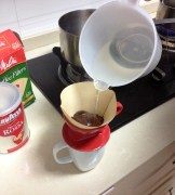 To start the drip process, water is slowly poured into the grounds. The water then drips into the mug.