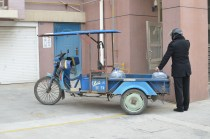 The water delivery guy brings us water in a 3 wheel cart. Many times he uses his scooter and hauls 4 - 5 gallon jugs.