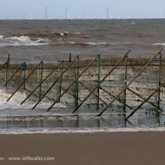 Dark Sea and Weathered Fence