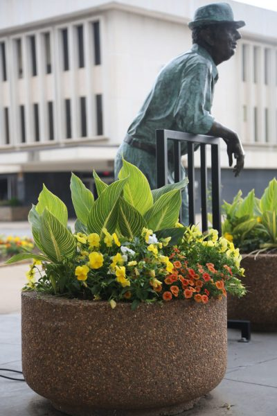 Old Man Payne is book-ended by two planters at the corner of 8th and Main in Downtown Stillwater.