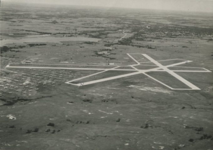 Aerial view of Searcy Field during the early 1940s when the field housed surplus military aircraft.