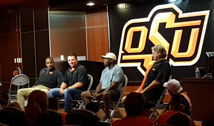 The final presentation was a first for Cowboy Football 101 and a highlight of the day: a Q&A with Cowboy Legends. Left to right: Donovan Woods (2004-07), Josh Fields (2001-03), Mark Moore (AP All American 1983-86), and Rusty Hilger (1981-1984).