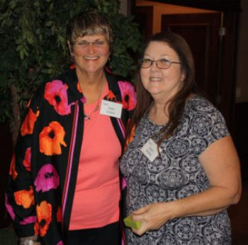 Joyce McKee pictured here with garden manager Jane Carter on the left, was recognized for 20 years of volunteer service in The Botanic Garden at OSU.