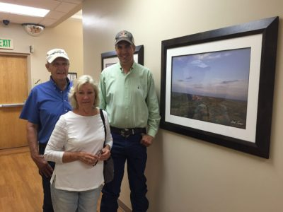 Kirk Turner and his parents tour Stillwater Medical Center to view dozens of his photographs on display. Photo courtesy of Shyla Eggers, SMC Director of Public Relations.