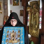 PHOTO:  The Nun Christonymphi with the the Miraculous Kursk Root Icon.