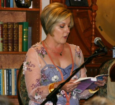 Laura Scott of Stillwater reading from her book <em>The Victory Daughter</em> at the May 2019 event.