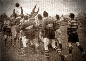 Russell Holloway leaps high to secure possession in Dursley's match with Old Centralians (1965)