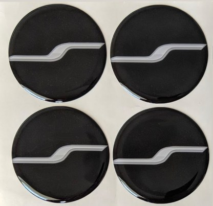 "kia stinger center caps with ""spinning s"" design"