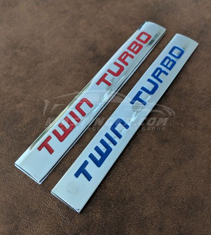 twin turbo badges in red and blue
