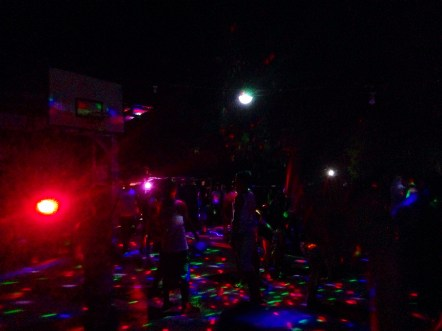 What is a basketball court during the day turns into a jungle disco at night
