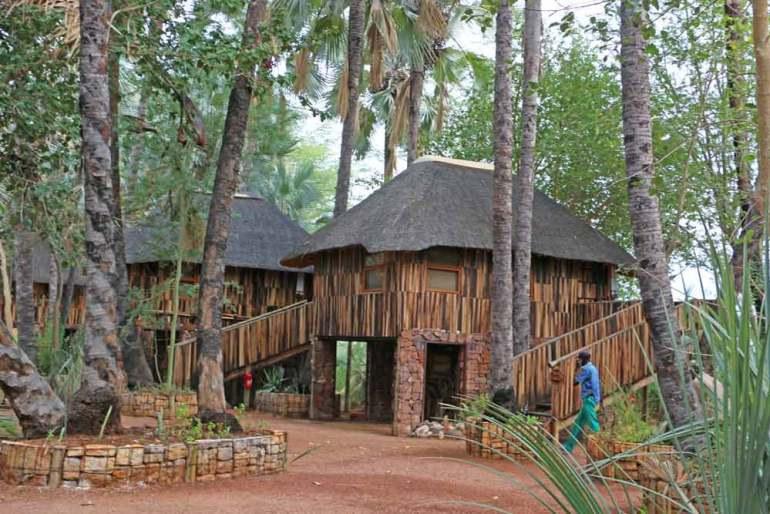 Wooden chalets at Epupa Falls campsite in Namibia