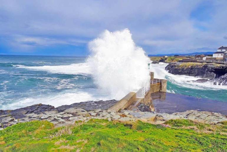 A wave breaking against the coast in Galicia