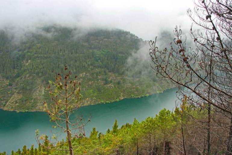 Embalse de Salime, a dam surrounded by the forest on the Camino in Asturias