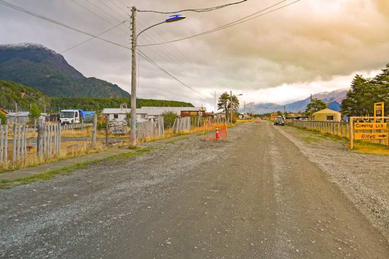 A small town of Villa O'Higgins and the gravel road of the Carretera Ausstral