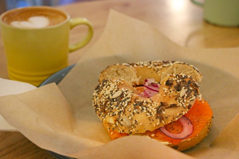 Cream cheese and salmon bagel and a cappuccino at my favorite bagel place in Cape Town