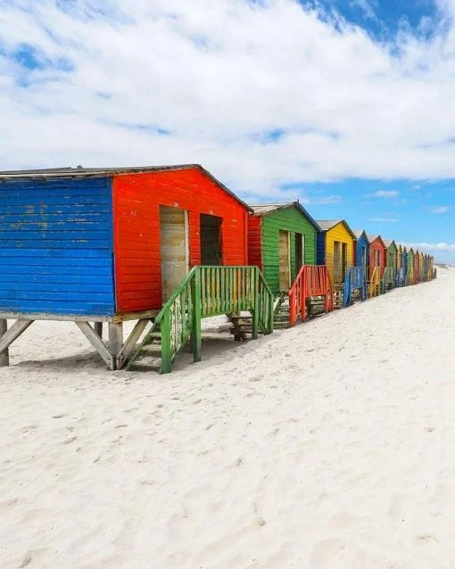 Colorful wooden beach cabins on Muizenberg beach in Cape Town