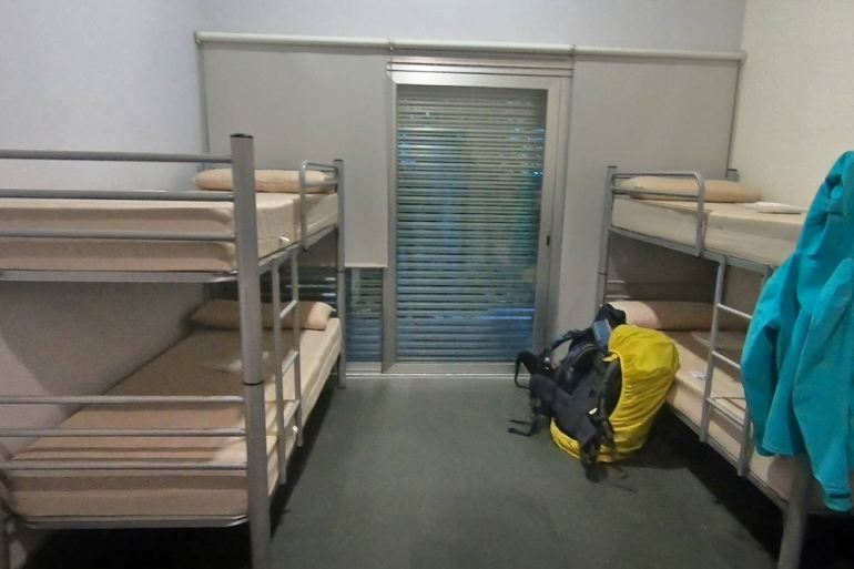 A shared room with bunk beds in a municipal albergue on the Camino
