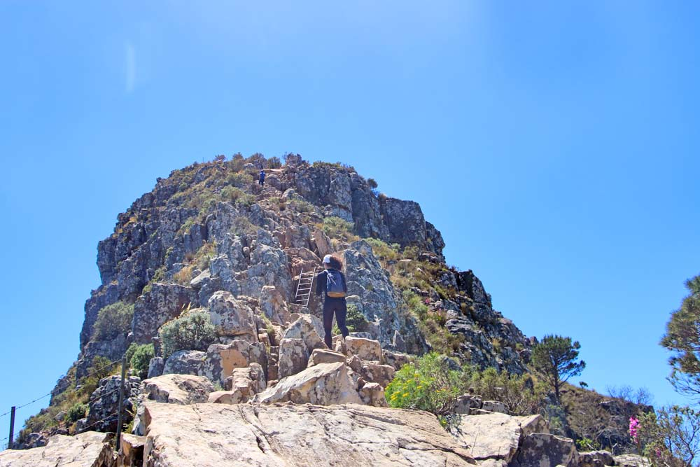 Alya on a rocky path climbing up Lion's Head