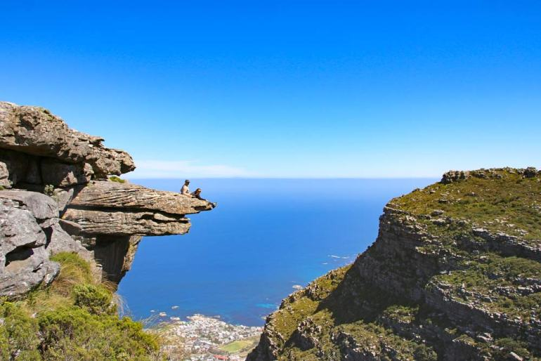 Stingy Nomads on the cliff called the diving board on Table Mountain