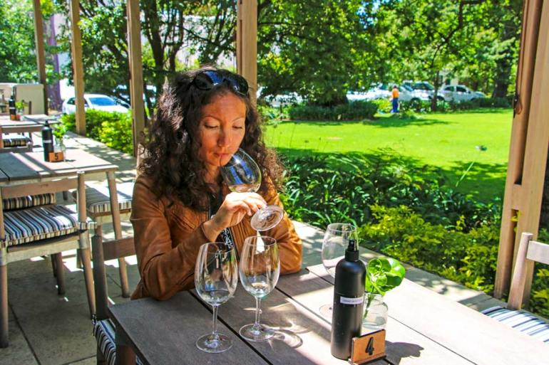 Wine tasting on the terrace overlooking the outstretched lawns of Buitenverwachting.