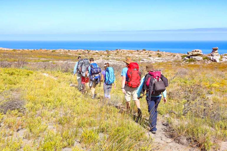 A group of hikers on the trail at Cape Point National Park