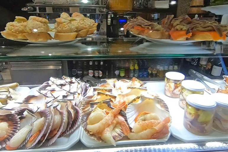 Seafood and cold meat tapas in a bar in Santiago de Compostela