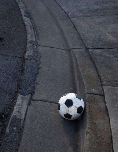 Soccer ball in gutter