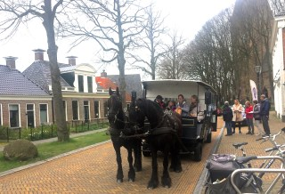 Frisian horse-drawn tram in front of Stinze Stiens.