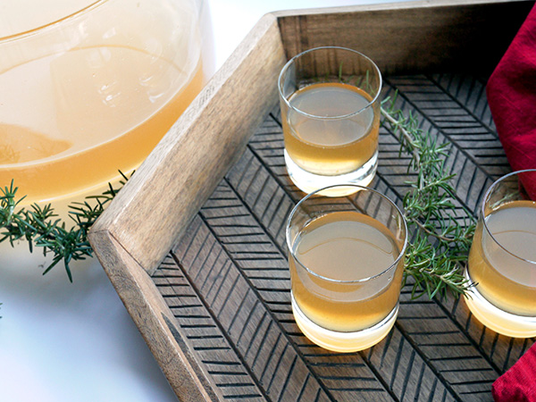 Smoked Rosemary Rum Punch // stirandstrain.com