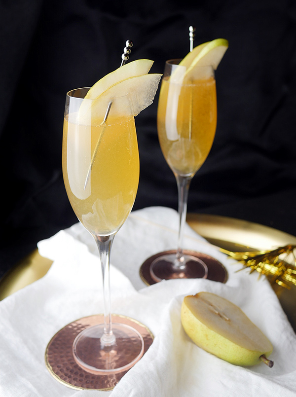 Spiced Pear Fizz Cocktails with Everclear // stirandstrain.com