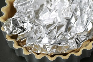Baking blind using crumpled tin foil instead of baking beans.