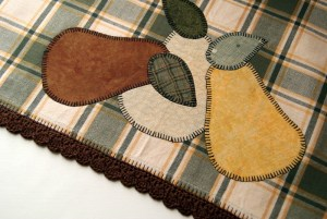 Completed country look edging on tea towel