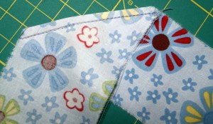 Trim seam close to stitching and press seam open