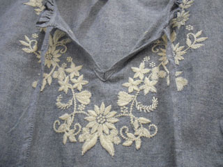 Embroidery round a collar