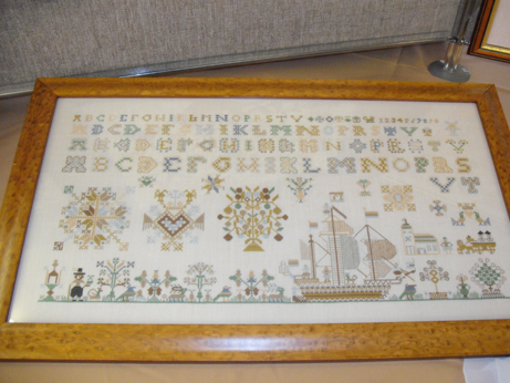 A traditional sampler in cross stitch
